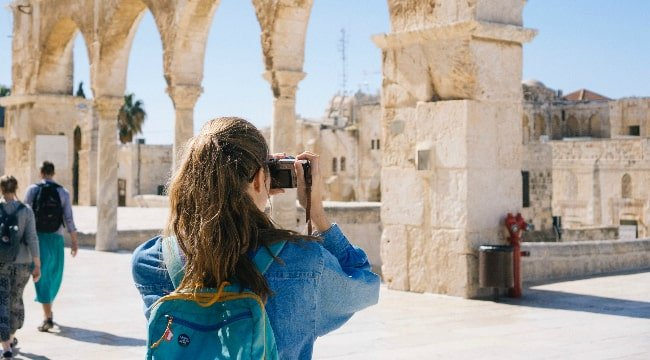 A girl enjoying a sightseeing tour in Israel