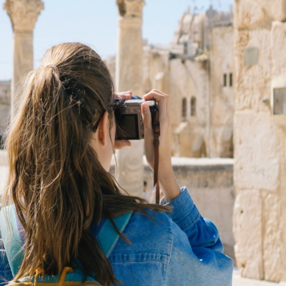A woman taking a picture during her Israel vacation